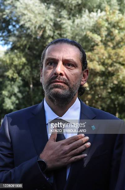 Former Lebanese prime minister Saad Hariri reacts as he leaves the UN-backed Special Tribunal for Lebanon at Leidschendam on August 18 after the...
