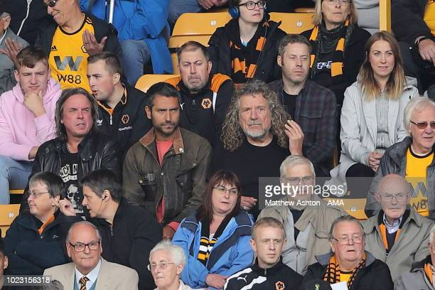 Former Led Zeppelin lead singer Robert Plant sits next to his son Logan Plant during the Premier League match between Wolverhampton Wanderers and...