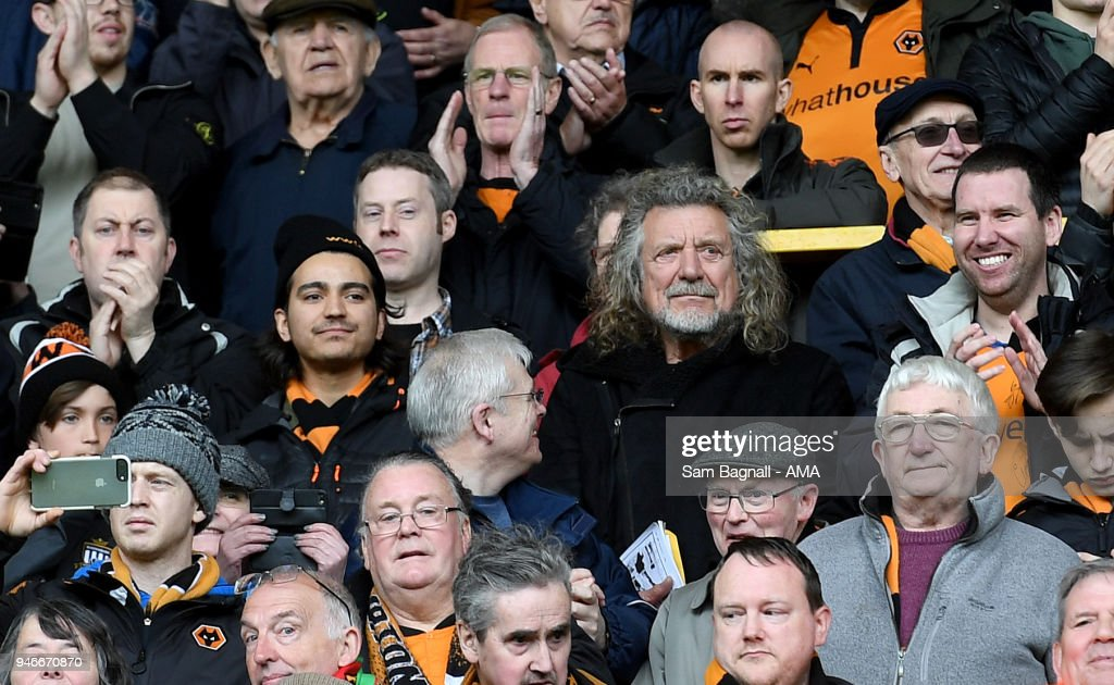 Former Led Zeppelin singer Robert Plant, a fan of Wolverhampton Wanderers celebrates promotion to the Premier League during the Sky Bet Championship match between Wolverhampton Wanderers and Birmingham City at Molineux on April 15, 2018 in Wolverhampton, England.