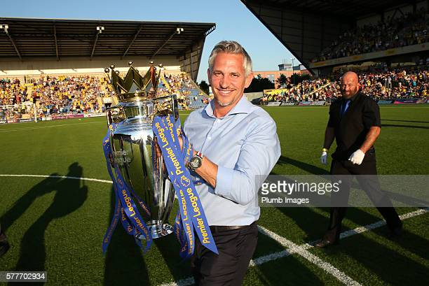 Former Leicester City player and 'Match of the Day' host Gary Lineker carries the Premier League trophy ahead of the pre season friendly between...