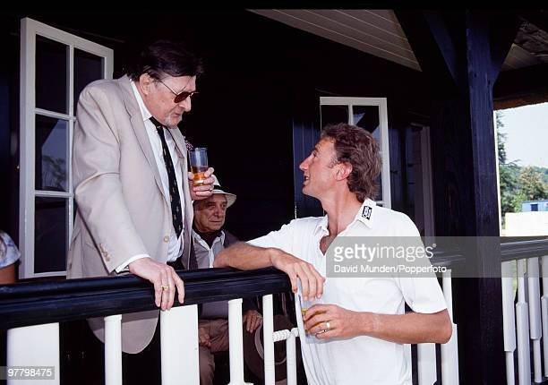 Former Leicestersire and England fast bowler Jonathan Agnew talking to John Paul Getty during the lunch interval in the match between John Paul...