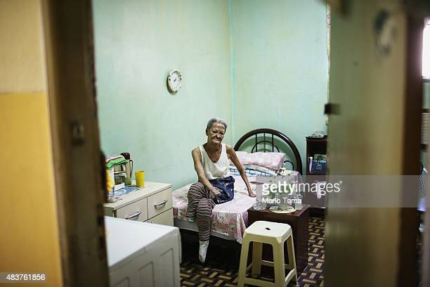 Former leprosy patient Tereza Alves dos Santos sits in her room in Hospital Curupaiti part of a former leprosy colony on June 10 2015 in the...