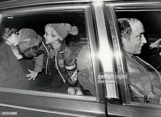 Former Liberal Leader Pierre Trudeau arrives home late 11/21 with sevenyearold son Justin and fiveyearold son Michel in the back seat of car