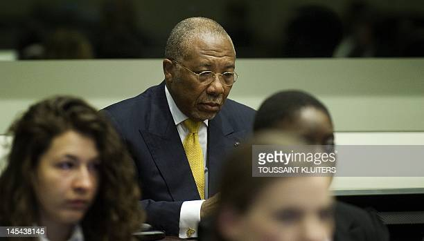 Former Liberian President Charles Taylor accused of arming Sierra Leone's rebels who paid him in blood diamonds listens on 30 May 2012 to the judge...