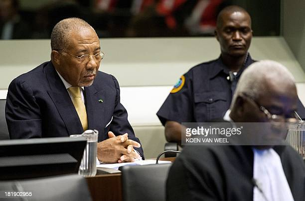 Former Liberian President Charles Taylor waits on September 26 2013 in the courtroom of the Special Court for Sierra Leone in The Hague before the...