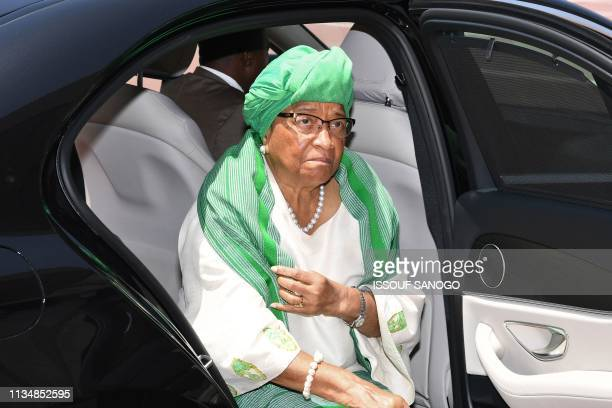 Former Liberian President Ellen Johnson Sirleaf arrives at the presidential palace before a meeting with Ivory Coast's President in Abidjan on April...