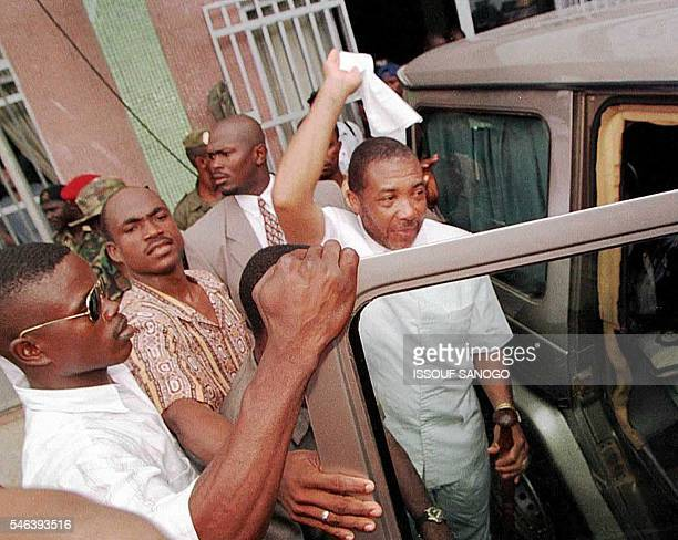 Former Liberian Warlord Charles Taylor salutes the crowd 24 July after his victory in the 19 July presidential elections was officially proclaimed by...
