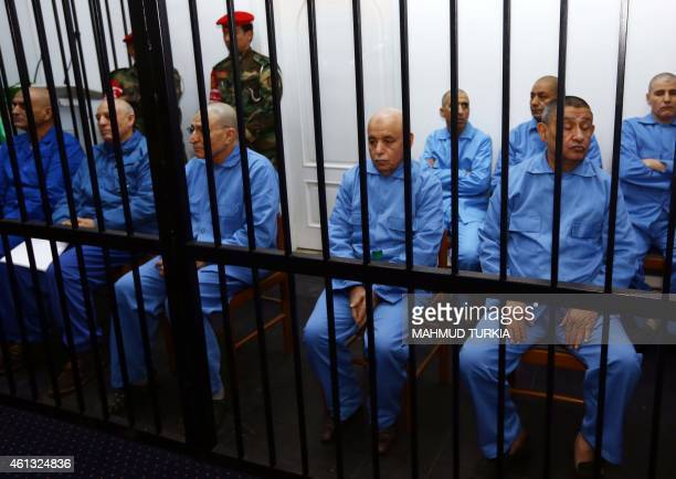 Former Libyan foreign intelligence chief Bouzid Dorda and Moamer Kadhafi's last premier alBaghdadi alMahmudi sit dressed in prison blues along with...