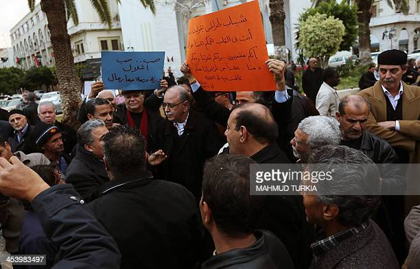 Former Libyan Prime Minister Abdul Rahim alKip and Tripoli residents demonstrate in Algeria Square in support of the people of Derna who are are...
