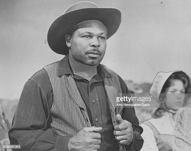 Former lightheavyweight boxing champion and actor Archie Moore wearing a cowboy hat during filming of the television show Wagon Train January 18 1964