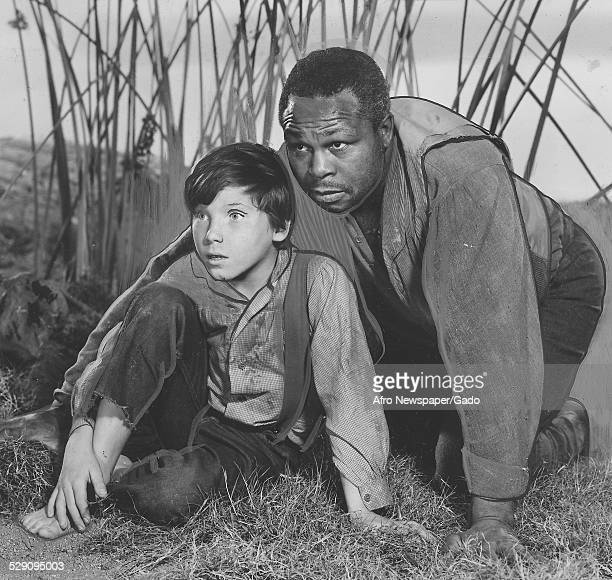 Former lightheavyweight boxing champion and actor Archie Moore and Eddie Hodges during the Broadway production of Mark Twain play Huckleberry Finn...