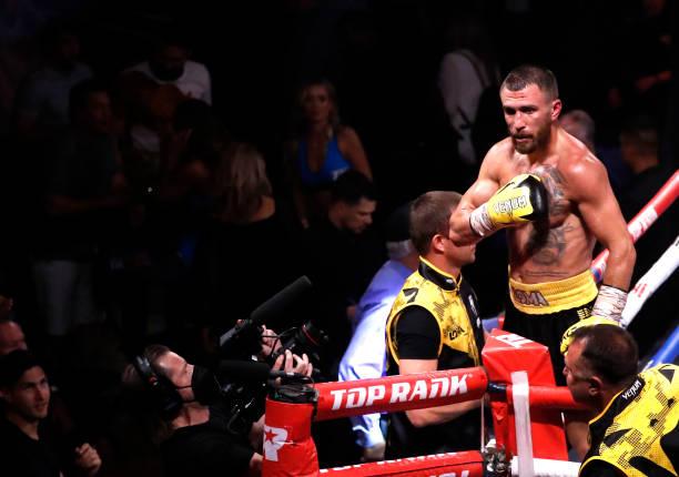 Former lightweight champion Vasiliy Lomachenko of Ukraine celebrates after defeating Masayoshi Nakatani of Japan in a lightweight bout at Virgin...