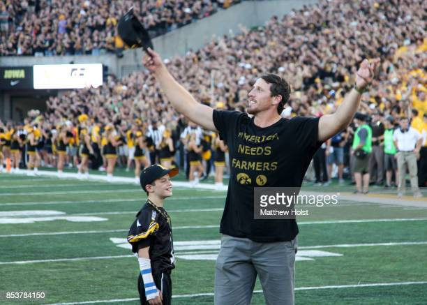 Former linebacker Chad Greenway of the Iowa Hawkeyes and Minnesota Vikings waves to the fans during the honorary captain announcement before the...