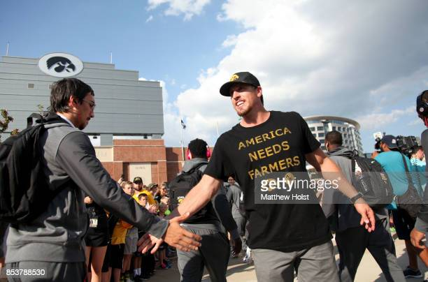 Former linebacker Chad Greenway of the Iowa Hawkeyes and Minnesota Vikings greets players as they arrive before the matchup against the Penn State...
