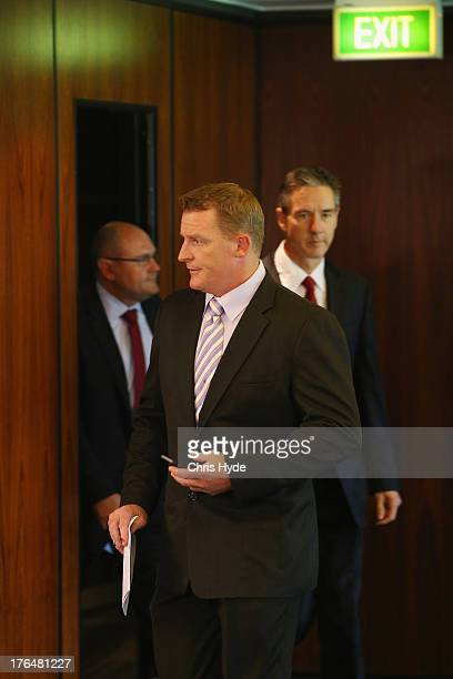 Former Lions coach Michael Voss arrives at a Brisbane Lions AFL media conference followed by Lions Chairman Angus Johnson and CEO Malcolm Holmes at...