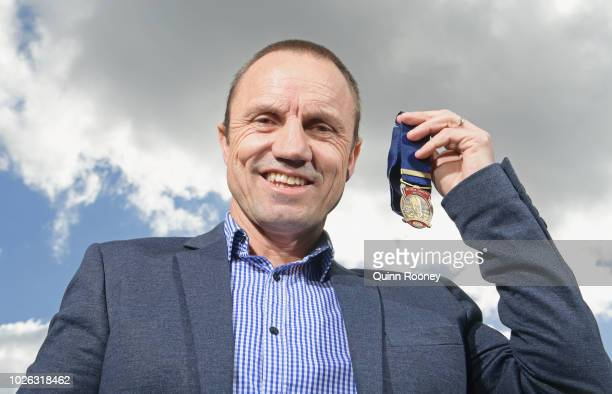 Former lions player and Norm Smith Medal presenter Shaun Hart poses with the medal during the 2018 Toyota AFL Finals Series Launch at Toyota CHQ Port...