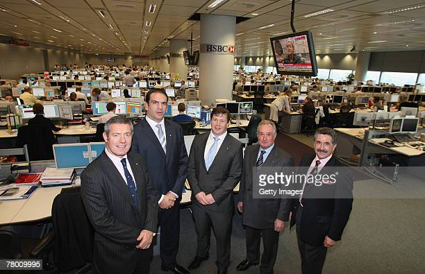 Former Lions players Gavin Hastings Martin Johnson Paul Wallace Gareth Edwards and Gerald Davies pose whilst on a tour of the trading floor prior to...