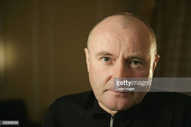 Former Live Aid artist Phil Collins poses for a portrait to commemorate the 20th anniversary of Live Aid on June 14 2005 in London England The...