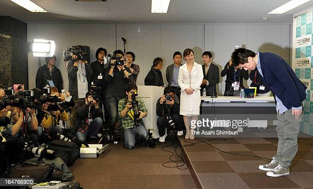 Former Livedoor president Takafumi Horie bows during a press conference after being paroled on March 27 2013 in Tokyo Japan Horie served 21 months in...