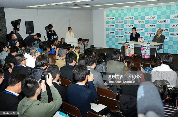 Former Livedoor president Takafumi Horie speaks during a press conference after being paroled on March 27 2013 in Tokyo Japan Horie served 21 months...