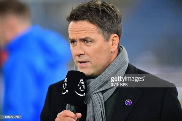 Former Liverpool and England player Michael Owen working for Amazon Prime TV works on the pitch ahead of the English Premier League football match...