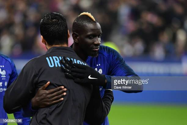 Former Liverpool club teammates Mamadou Sakho of France and Luis Suarez of Uruguay greet each other before the International Friendly match between...