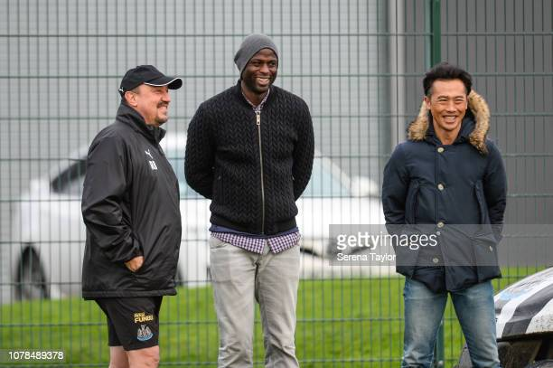 Former Liverpool Defender and current Seattle Sounders assistant coach Djimi Traore poses for a photo with Newcastle United Manager Rafael Benitez...
