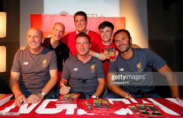 Former Liverpool FC players Gary McAllister Vladimir Smicer and Patrick Berger pose with fans during the LFC Supporters Club Event at FC Magnet Bar...