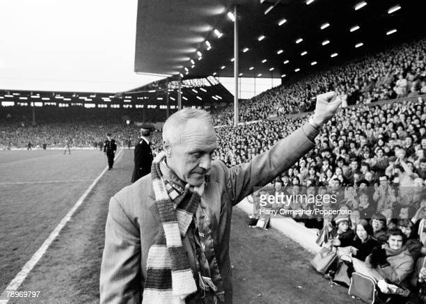 Former Liverpool manager Bill Shankly acknowledges the fans as he leaves the field before his Testimonial match between a Liverpool XI and a Don...