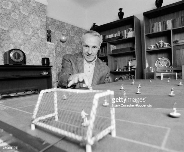 Football May 1976 Liverpool FC Manager Bill Shankly practices his Subbuteo skills at home