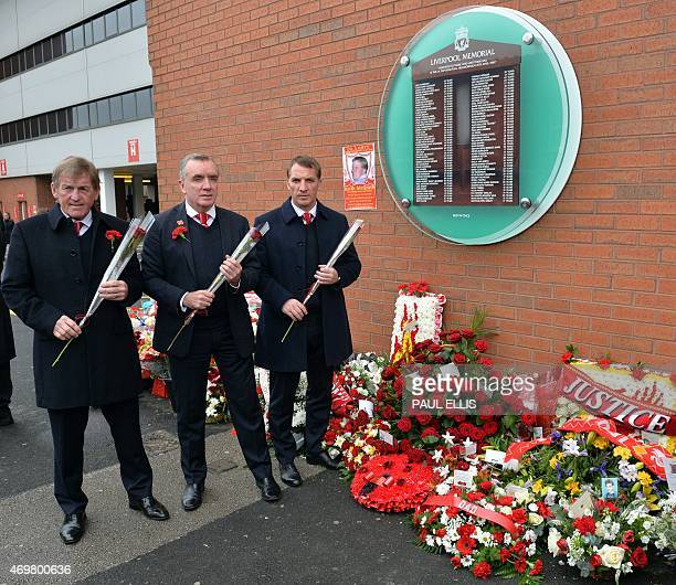 Former Liverpool player and manager Kenny Dalglish Chief Executive Ian Ayre and current manager Brendan Rodgers lay flowers at the temporary...