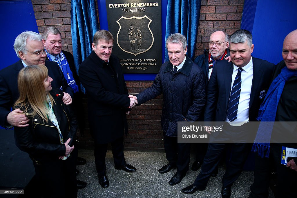 Former Liverpool player and manager Kenny Dalglish shakes hands with former Everton player and manager Colin Harvey as Everton chairman Bill Kenwright and Margaret Aspinall, Chair of the Hillsborough Family Support Group, look on during the unveiling of a memorial plaque in tribute to the 96 victims of the Hillsborough tragedy, outside the stadium before the Barclays Premier League match between Everton and Liverpool at Goodison Park on February 7, 2015 in Liverpool, England.