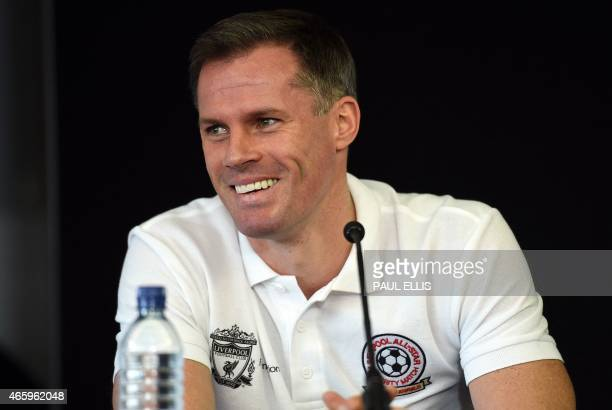 Former Liverpool player Jamie Carragher attends a press conference with Liverpool's English captain and midfielder Steven Gerrard at Anfield in...