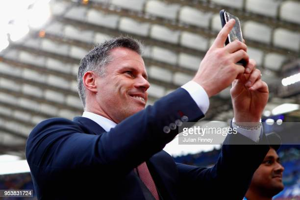 Former Liverpool player Jamie Carragher photographs the Liverpool supporters on his phone prior to the UEFA Champions League Semi Final Second Leg...