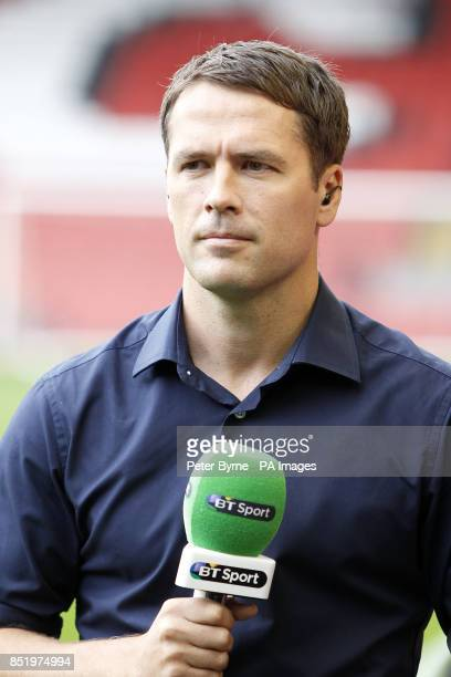 Former Liverpool Player Michael Owen commentates for BT Sport during the Barclays Premier League match at Anfield Liverpool