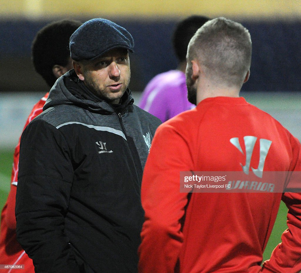 Former Liverpool player Rob Jones talks to Ryan McLaughlin after the U21 Premier League game between Liverpool and West Ham United at The Swansway Chester Stadium on March 20, 2015 in Chester, England.