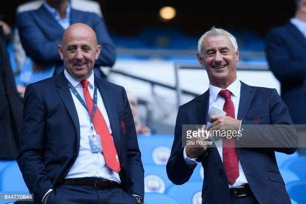 Former Liverpool players Gary McAllister and Ian Rush are seen in the stands prior to the Premier League match between Manchester City and Liverpool...