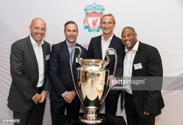 Former Liverpool players Gary McAllister Jason McAteer Sami Hyypia John Barnes pose for photo with the UEFA Champions League trophy in front during...