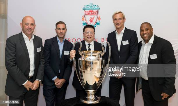 Former Liverpool players Gary McAllister Jason McAteer Sami Hyypia John Barnes and guests pose for photo with the UEFA Champions League trophy in...