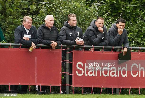 Former Liverpool players Kenny Dalglish and Steve Heighway with Academy Director Alex Inglethorpe Phil Roscoe and Nick Clarke watch the action during...