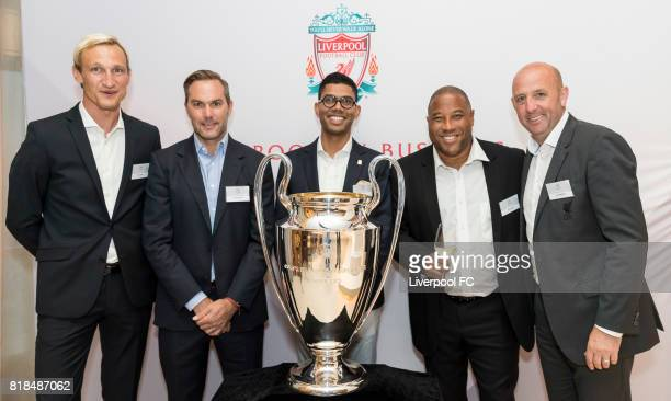Former Liverpool players Sami Hyypia Jason McAteer John Barnes Gary McAllister and guests pose for photo with the UEFA Champions League trophy in...