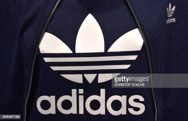 A former logo of the German sportswear maker Adidas is on display in the company headquarters in Herzogenaurach southern Germany during the annual...