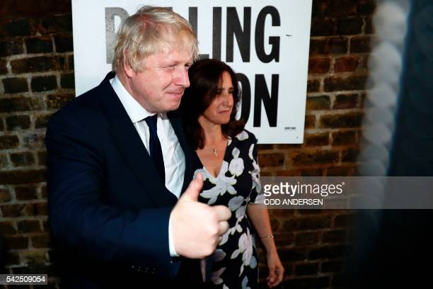 Former London Mayor and Vote Leave campaigner Boris Johnson and his wife Marina Wheeler pose for the media outside a polling station in north London...