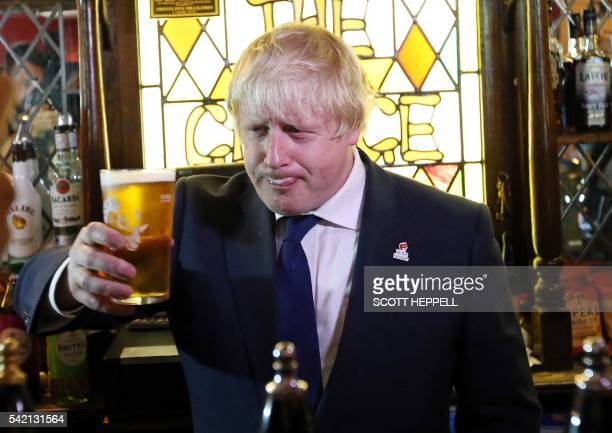 Former London Mayor and 'Vote Leave' campaigner Boris Johnson is pictured with a pint of beer ahead of meeting with members of the public and...