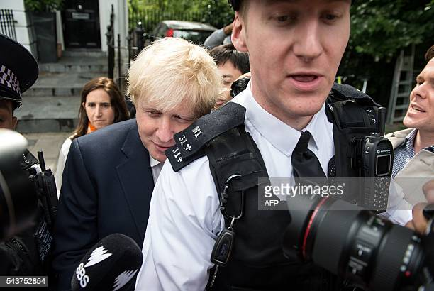 Former London Mayor Boris Johnson is escorted by police personnel as he leaves his home in London on June 30 2016 Brexit campaigner Michael Gove...
