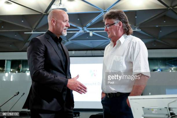 Former Lopavent CEO Rainer Schaller and plaintiff Manfred Reissaus shake hands prior to the Love Parade trial at the CCD-East on May 22, 2018 in...