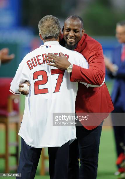Former Los Angeles Angels outfielder Vladimir Guerrero hugs Angels owner Arte Marino after Guerrero tossed out the first pitch to Marino after...