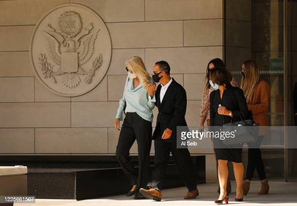 Former Los Angeles City Councilman Mitchell Englander departs Los Angeles federal courthouse in downtown LA Tuesday with his wife Jayne attorney and...