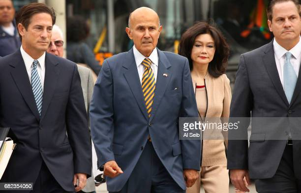 Former Los Angeles County sheriff Lee Baca walks with his wife and attorney's to the U.S. Courthouse in Los Angeles for his scheduled sentencing on...