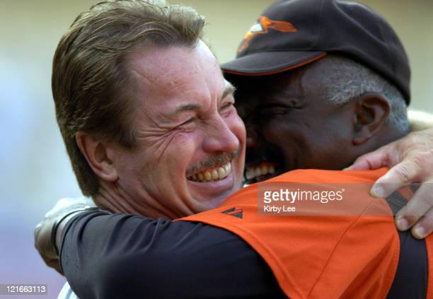 Former Los Angeles Dodger Ron Cey is embraced by Baltimore Orioles bullpen coach Elrod Hendricks during batting practice at Dodger Stadium on June...